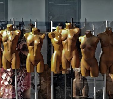 "Row of store mannequins with ""perfect bodies"" as an advert against plastic surgery Scotland"